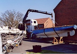 We arranged a truck mounted crane to lift the boat on to 'chocks' for some winter maintenance.