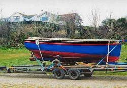 A cornish crabber loaded in Goran Haven, Cornwall with its own launch trolley to be transported to Loch Long, Scotland